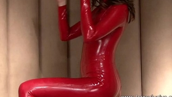 Red latex fetishist Olivias rubber outfit posing and unequalled women softcore made-up