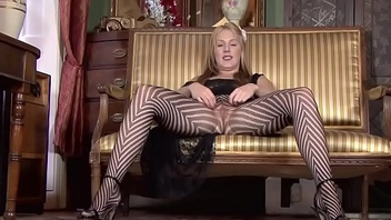 Cute slut rubs her legs in pantyhose