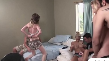 Two hot babes pounded by team a few horny men