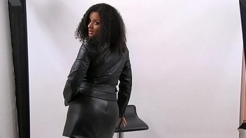 Ebony looker posing there leather jacket, skirt, top and high boots